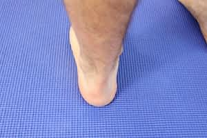 back of the heel Achilles tendonitis pain ESWT treatment